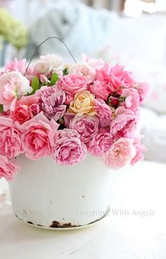 Roses in a white enamel bucket