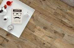 Dakota by Flaviker. Porcelain tiles exhibiting all of the charming imperfections of rustic wood.