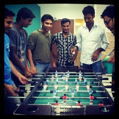Freshdeskers cooling it off. Foosball is super awesome stress buster!