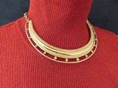Styling is simple with the sleek design of this vintage Monet rigid choker necklace.