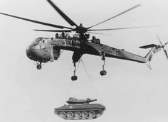 US Army heavy lift helicopter (CH-54) lifting a tank during the ...