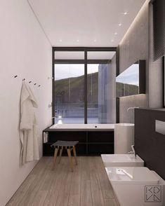 La seule pièce close dans cette résidence est la salle de bains qui suit l'intérieur minimaliste