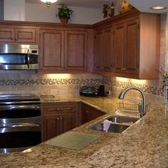 Black and brown granite with maple cabinets kitchen