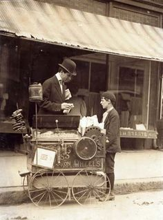 11 year old peanut vendor with his cart selling peanuts on the street in Wilmington, Delaware. 1910.