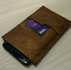 Handmade leather phone sleve from The Anvil Workshop