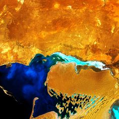 The Dardzha Peninsula in western Turkmenistan lies among the shallow coastal terraces of the Caspian Sea. Strong winds create huge sand dunes near the water, some of which are partly submerged. Farther inland, the dunes transition to low sand plains. Nasa, Photo Voyage, Earth From Space, Art Abstrait, Aerial Photography, Landscape Photography, Aerial View, Oeuvre D'art, Abstract Landscape
