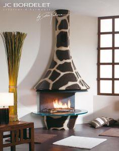 JC Bordelet Eva 992 - Girafe Wood Burning Stove designed by Paco Rabanne. I think i had better start saving up for one of these!