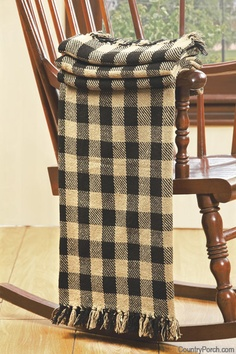 A classic buffalo check throw, in black & white, on a great rocking chair.
