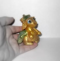 Goldie the Dragon by CuteNclay on Etsy, $16.00