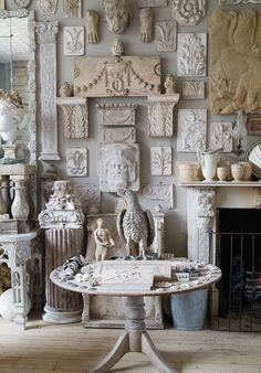 Culture & class can be reflected in wall art & galleries. This gorg gallery of white pottery pieces hanging over a beautifully ornate fireplace is absolutely breathtaking.