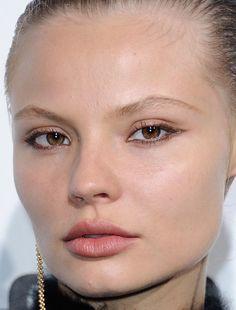 Close-up of Magdalena Frackowiak at the 2016 Paris Fashion Week amfAR Dinner.