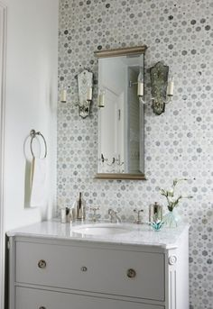 Sunflower Carrara Thassos Tile, Transitional, bathroom, Sarah Richardson Design Stunning bathroom with white bathroom vanity with marble top, mirror flanked by antique sconces and Saltillo Imports Large Sunflower Carrara Thassos Tiles backsplash. Bathroom Renos, White Bathroom, Modern Bathroom, Washroom, Bathroom Remodeling, Remodeling Ideas, Bathroom Interior, Bathroom Tiling, Light Bathroom