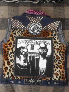 dystopia patched and studded crust punk vest. $150.00, via Etsy.