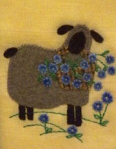 Sheep with flower basket - I love the tilt of this sheep's head! pattern for some future project.