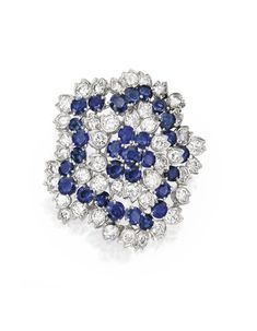 PLATINUM, SAPPHIRE AND DIAMOND BROOCH, VAN CLEEF & ARPELS, 1967. Designed as a flowerhead set with round diamonds weighing approximately 10.20 carats, and round sapphires weighing approximately 7.75 carats, signed VCA, numbered N.Y. 37180.  With signed box.