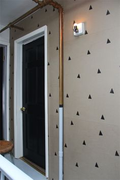 pretty black doors and hand stamped (easy) wallpaper - via Brooklyn to West