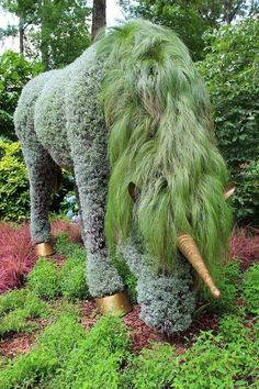 A unicorn plant sulpture | 22 Weird And Wonderful Features You'll Wish You Had In Your Garden