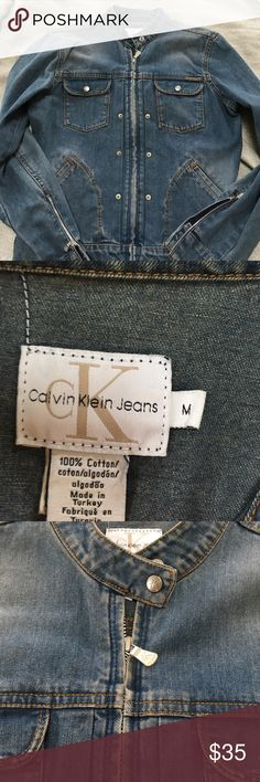 Calvin Klein jeans motorcycle style jacket size M Calvin Klein jeans motorcycle style jacket size M.  Jacket is zip up and  there are zippers on the sleeves.  I love this jacket but it no longer fits me after having my children. A great classic addition to anyone's wardrobe.  Make an offer Calvin Klein Jeans Jackets & Coats Jean Jackets