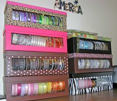 Ribbon storage out of shoe boxes, wonder if this could be done for duct tape... but in a way that makes it easy to pull and tug on