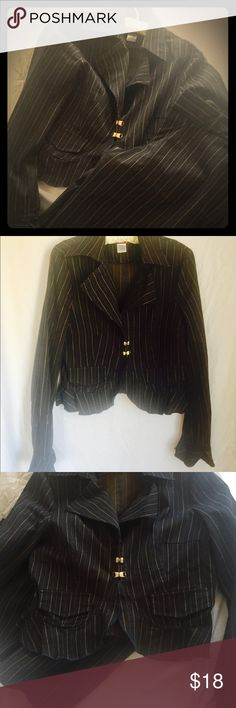 Pant suit Dark gray pinstripe pant suit. These are not full length pants they are more like a Bermuda length right at or below the knees. The top is fitted and the pin stripes are not white they are more of a golden apricot color. 2 rhinestone embellished closures. The top is size large and the bottoms are a size 9. In great shape! Other