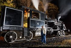 James tends to Heisler No. 6 during Saturday evening's photo session at the water tower as part of the Cass Scenic Railroad's annual Fall Photography Workshop.
