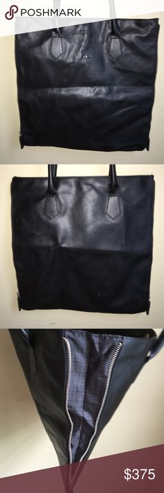 """GIVENCHY LEATHER  BAG Authentic Givenchy parfums in excellent condition honestly is new because never used black  leather zipper sides TOTE fully lined with logo fabrics and Givenchy logo on front zipper sides csn open and Givenchy more extra space- interior slip pocket really cute TOTE and hard to find.  Dimention approximatlely: 14""""height x14""""length Givenchy Bags Totes"""