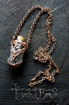 Handcrafted Copper Black Moss Singing Quartz by TheTwystedBriar Handcrafted Bone White Skeleton Leaf and opal Glass Vessel Pendant Necklace Mori Goth Dark Spooky Woodland Fantasy Jewelry Witchcraft Amulet