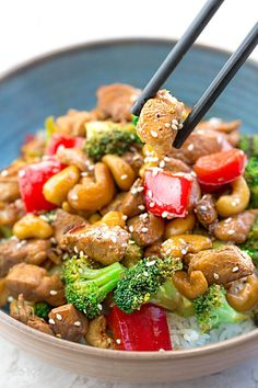 Healthy Cashew Chicken - an easy 20 minute guilt-free gluten free skinny version (plus paleo friendly options) of the popular classic Chinese takeout dish. Plus a serving of tender crisp broccoli and red bell peppers for a healthier meal. Best of all, this recipe comes together in less than 30 minutes in just one pan and perfect for busy weeknights!