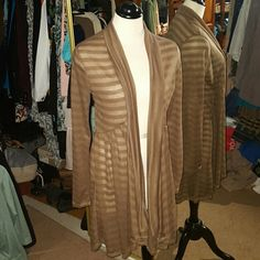 PRETTY YOUNG THING FLYAWAY CARDIGAN, SIZE M This subtlety striped flyaway cardigan is quite lovely in a basic tan or light brown color. Perfect to throw over a cami or bare top. Size medium but will fit a large too. New, never worn. Pretty young Thing Sweaters Cardigans