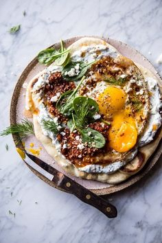 Turkish Fried Eggs in Herbed Yogurt- creamy-garlicy-herby yogurt, spicy butter sauce, sun-dried tomato pesto, soft & fluffy naan :) At halfbakedharvest.com
