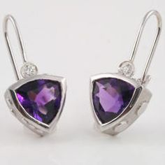 14K White Gold- Wear a piece of the universe with these charming earrings. Containing 3.26 carats of #Amethysts and 0.10 carat of diamonds, these earrings are clean and simple with alluring details.