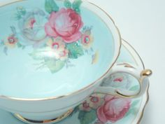 Paragon tea cup and saucer. Made in England between 1952 and 1960    Pale blue ground with mixed flowers on both the cup and saucer. Finished