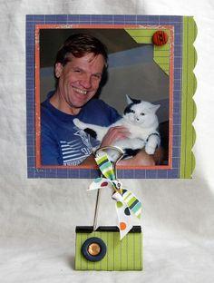 so cute!  binder clips as photo holders