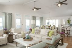 Gorgeous beach home designed by Liz Carroll. I adore the pale aqua, lime, and lavender accents paired with plenty of fresh white.