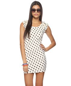 A bodycon ponte dress with an allover polka dot print and ruffled cap sleeves. Scoop neckline. Seam accent down center back. Medium weight. Knit.