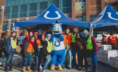 Employees from our Indianapolis offices, along with Indianapolis Colts mascot, Blue, helped to pack and distribute food this morning for the annual Horseshoe Helpings event. All of the Thanksgiving dinner staples were distributed to 2,000 local families in need.