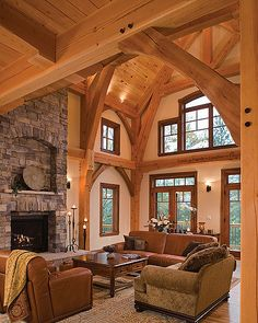 Elegant arches frame the great room as large windows allow natural light to accent the room's décor.