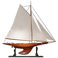 A wonderful large scale pond yacht with plank on frame hull and lead weighted keel; Circa 1910. Mounted on ebonised stand with engraved name plate 'Nyria'. England c. 1910