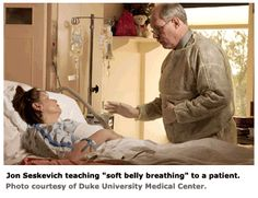 """Jon Seskevich teaches """"soft belly breathing"""" to a patient."""