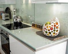 Glass countertop and backsplash.