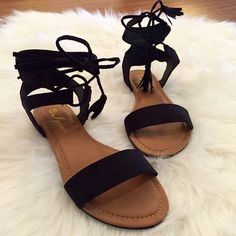 Black Tassel & Ankle Tie Sandals 9 Size 9! Black Faux Suede Sandal. Ankle Tie with Tassel Detail. Fit true to size. Faux Suede. Faux Leather. Come brand new in box. Available in 6, 6.5, 7, 7.5, 8, 8.5, 9, & 10. One of each size available. Bundle for 15% discount on 3+ items. Only offers made through the offer button with be considered. Thank you! Boutique Shoes Sandals