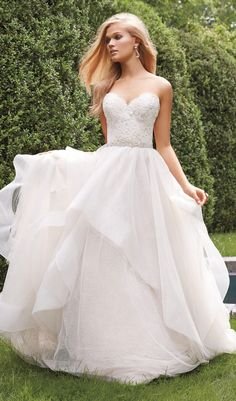 Try this ivory / cashmere dotted tulle wedding dress with horsehair edged cascades throughout skirt and ivory lace bodice. Strapless sweetheart neckline wedding dress from Alvina Valenta. Available at Schaffer's in Des Moines, Iowa. Wedding Dress Info: ALVINA VALENTA – STYLE 9551.