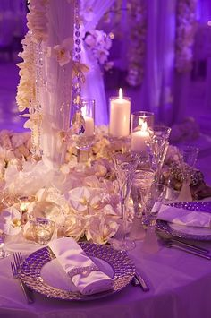 Tall white centerpieces with dripping crystals and flower bases. Also, notice the rhinestone napkin rings...