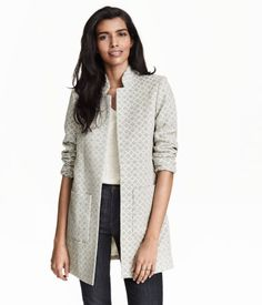 Coat in a jacquard-weave cotton blend with a stand-up collar, front pockets, and no buttons. Unlined.