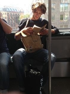 Hot Guy Reading Book. That hair. Oooooh.