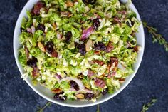 Brussels Sprouts Salad with Citrus Vinaigrette- Shredded Brussels are a hearty stand-in for lettuce in this salad that's studded w/almonds, cherries & bacon