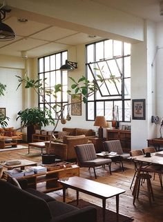 Warehouse renovated in a fusion of industrial and mid-century modern styles. Love the use of plant to add some life to the decor.