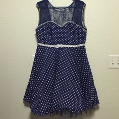 Vintage Polka Dot and Lace Sweetheart Dress Gorgeous navy blue and white polka dot dress has a sweetheart neck, low back, then lace trim for the sleeves. Tulle on the bottom for a fuller effect. Size XXL, fits size 14-16. Bust runs large. Friday On My Mind  Dresses Backless
