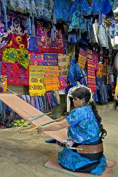 A woman weaves on a backstrap loom in the village of Zinacantan in the highlands of Chiapas. Tzotzil