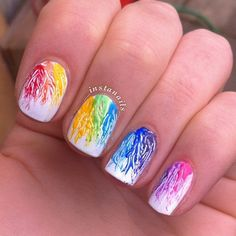 Leaf like watercolor nail art design. Very pretty and creative. Use rainbow hues for this design to make it look enticing and continuous.